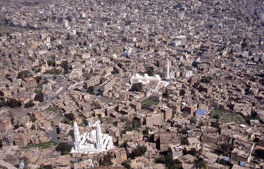 Taizz, Yemen. In the foreground, Aschrafiyya Mosque, September 1, 2004. By Bezur, and republished under Creative Commons Attribution-Share Alike 3.0, Wikipedia source address: https://commons.wikimedia.org/wiki/File:Taizz.jpg.